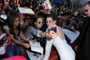 Twilight saga eclipse Kristen Stewart poses with fans at the premiere in LA