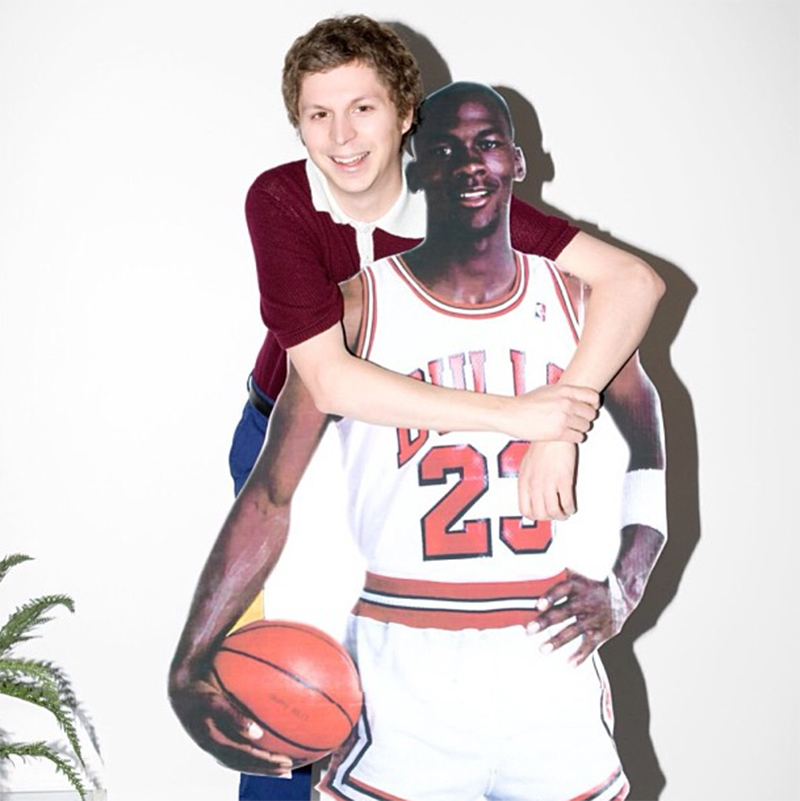 Michael Cera hugging a cutout of Michael Jordan