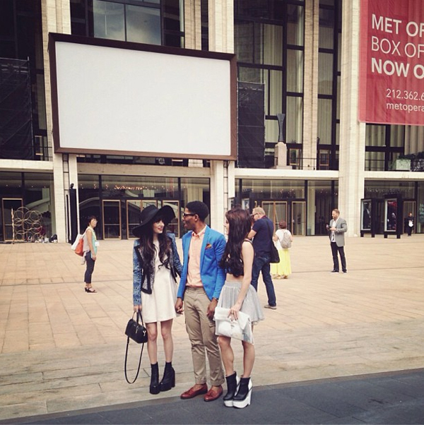 Bloggers huddle outside Lincoln Centre at NYFW. Image via @olivia_s1021 from Instagram