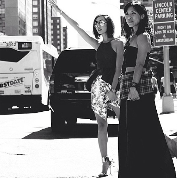 Chriselle Lim hailing a taxi at New York Fashion Week wearing the Jump Then Fall Skirt from Paradise Found