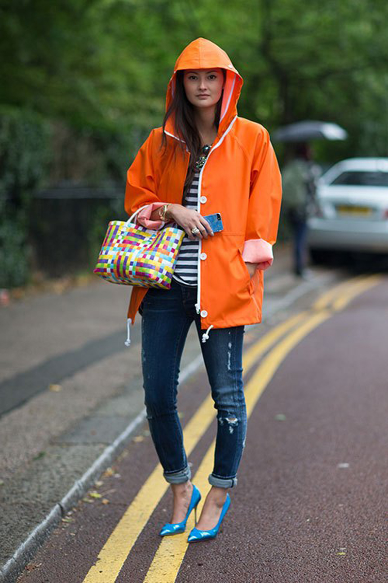London fashion blogger Peony Lim (who wore the Wildfox Sun Winona Frames to NYFW last season) rolled up the sleeves of her cute orange mac (Elvine x Grundens) and teamed it with skinny jeans (Genetic) and heels.