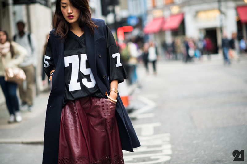 LFW attendant pairing a baller shirt (think Stylestalker Baller) with a sleeveless navy coat and a bordeaux pleather skirt.