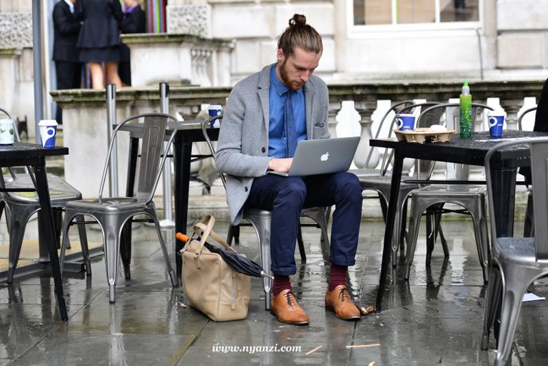 Fashion week attendant enjoying a break. Preppy menswear style with a casual edge. Think Elvine.