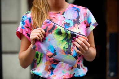 Be Frassy wearing the clutch and tee