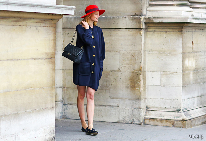 Candice Lake wearing a red hat with a navy and black outfit at Paris Fashion Week Spring Summer 14