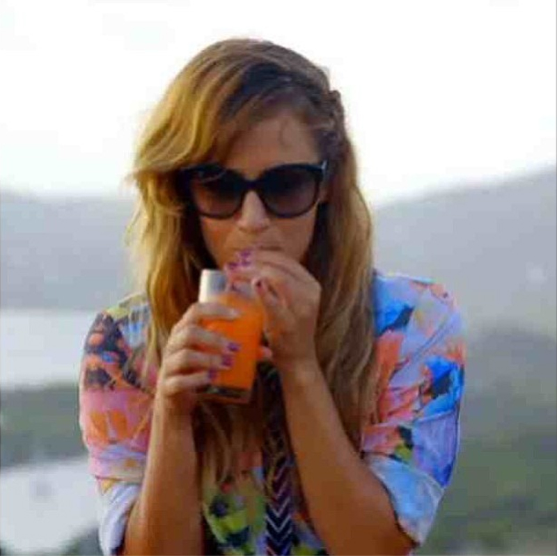Caroline Flack sipping in electric rose