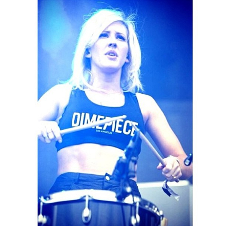 Drumming away in a Dimepiece logo crop top