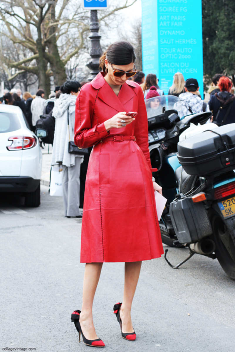 Giovanna Battaglia in a red leather Valentino coat outside the Chanel show in Paris