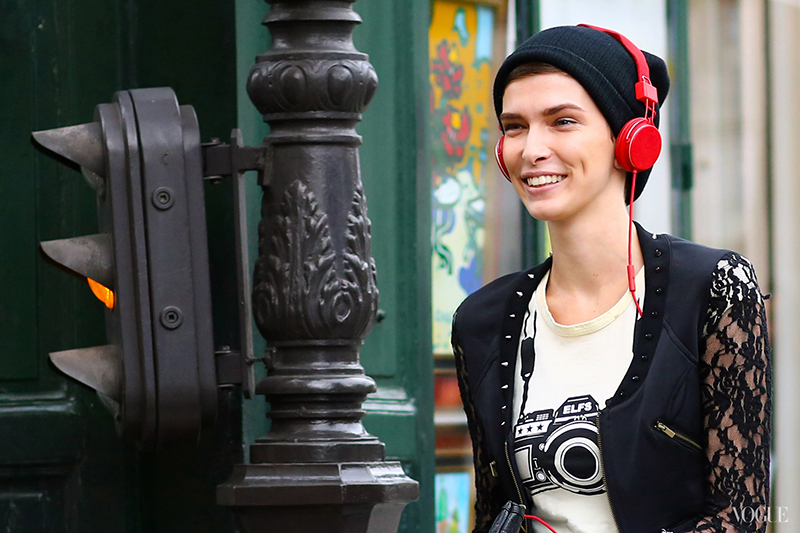 PFW attendant wearing red headphones over a navy beanie