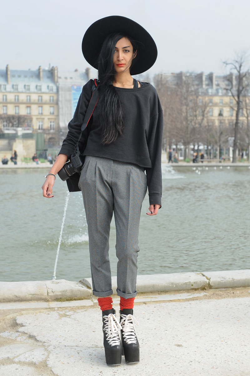 This Parisian tucked red socks into her Jeffrey Campbell shoes adding a splash of colour to her monochromatic outfit