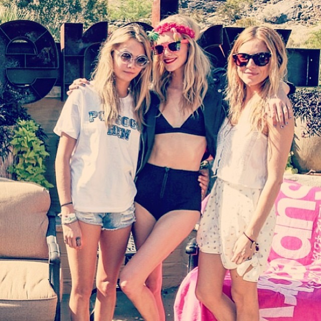 Cara Delevingne getting involved in some poolside posing in Wildfox Sun Twiggy Frame with sister Poppy Delevingne and Sienna Miller